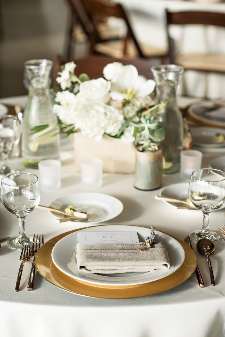 Copper chargers added warmth to each dining table, which was topped with succulents and some crisp white blossoms—hydrangeas and garden roses.