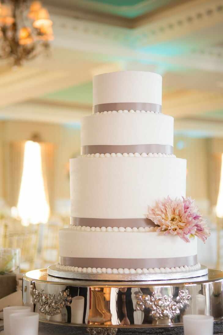Each layers of the four tier cake was decorated with clay colored ribbon and pearl piping. Two fresh pink dahlias added the finishing touch.
