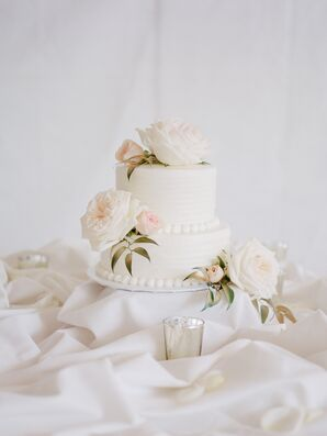 Two-Tier White Wedding Cake with Lush Roses