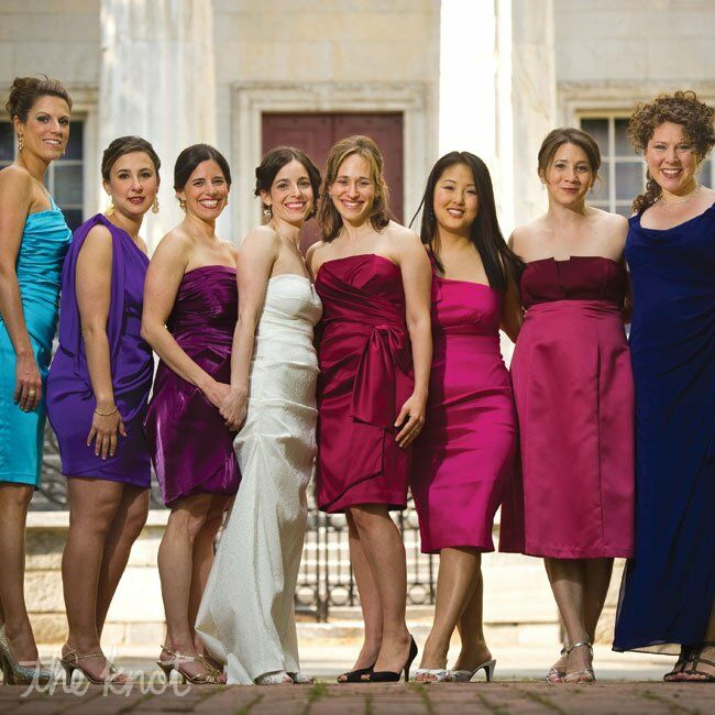 Nina had 7 bridesmaids total. She wanted their dresses to reflect their individual personalities so she gave them a color palette to work from including jewel tones: pink, purple, blue, green, and asked that the dresses be T-length or knee-length.