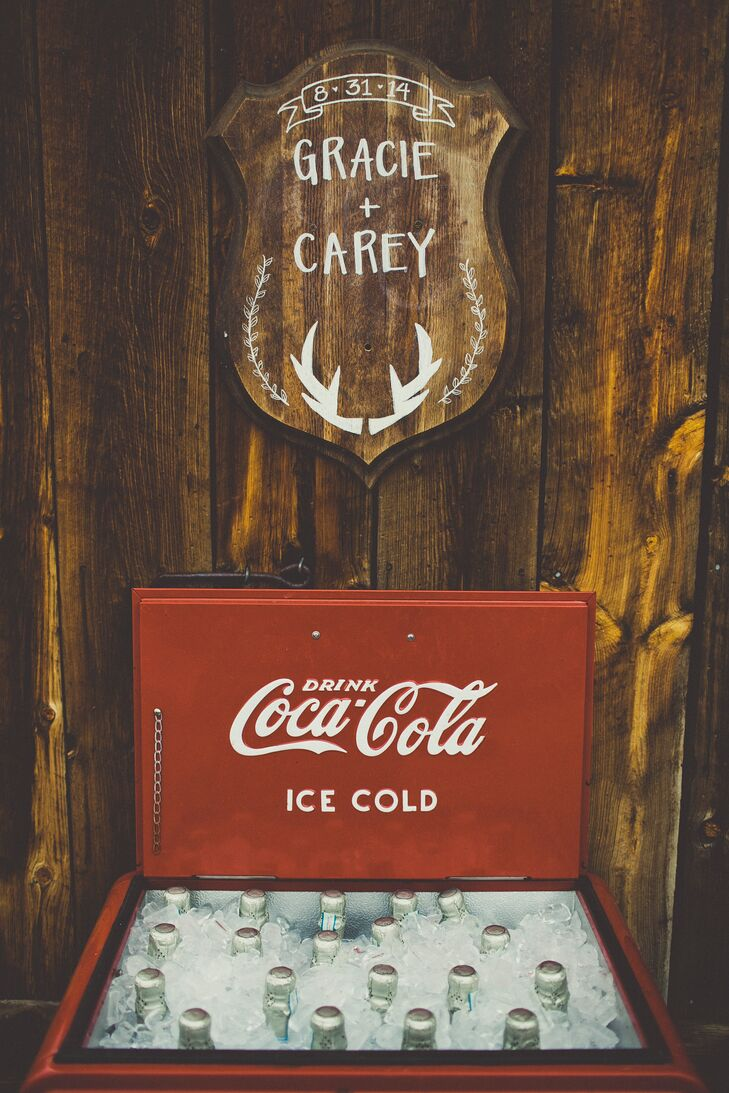 Gracie and Carey added vintage details throughout their wedding such as the Coca-Cola cooler that was used for the champagne.