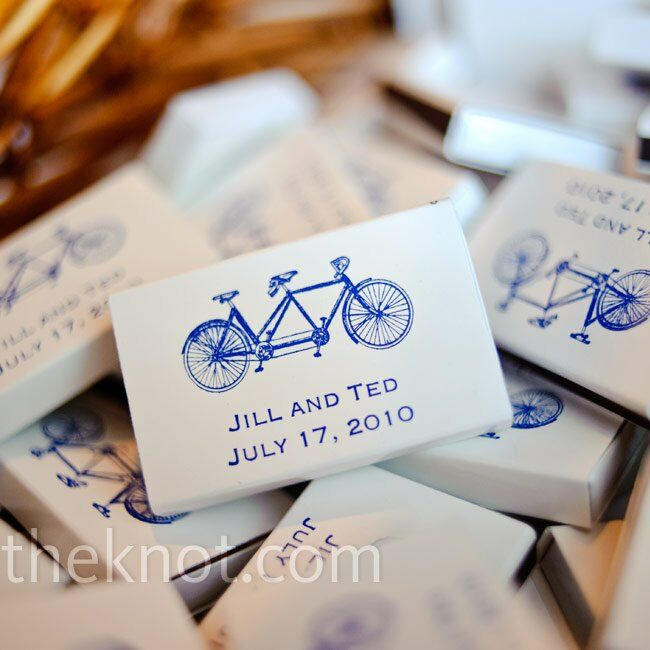 White matchboxes with the couple's tandem bike logo were on-hand for guests to take home.
