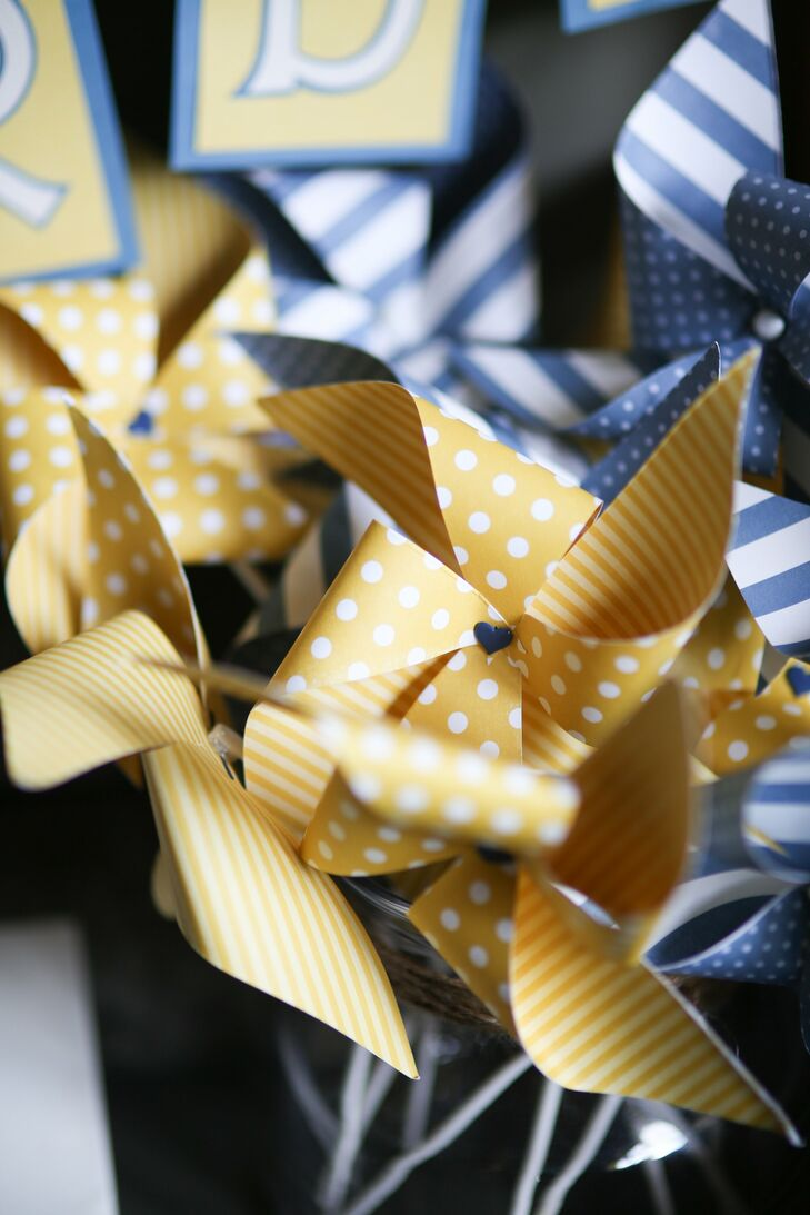 The couple made pinwheels from blue and yellow polka dot ribbon for a fun, playful favor.