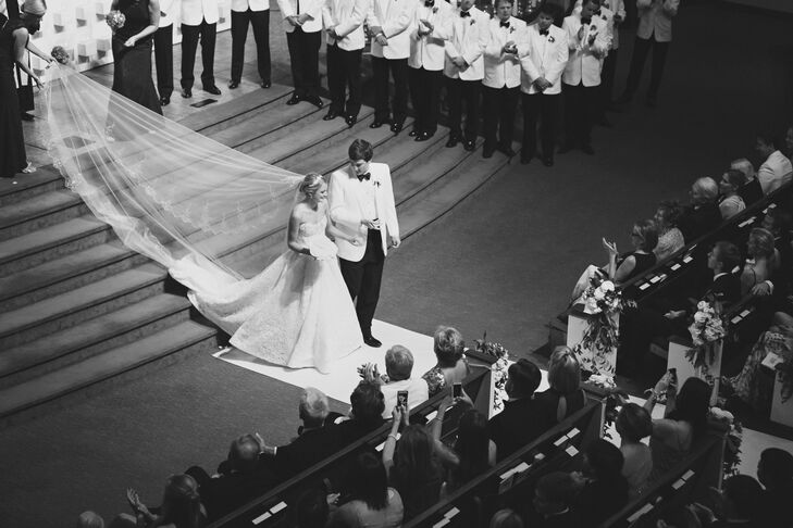 """Kelly and Walt's recessional was the highlight of their ceremony. As they walked up the aisle as husband and wife, two trumpet players followed behind while one of the  quartet's soloists sang """"Happy"""" by Pharrell Williams."""