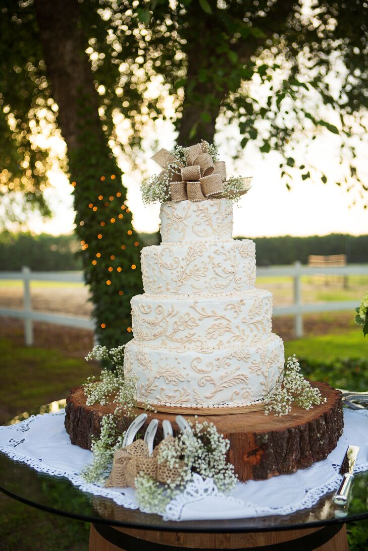 """Our cake was delicately decorated with baby's breath and burlap, and positioned on a real tree slab with horseshoes strategically arranged,"" says Erin. ""I must say, was the most beautiful cake I'd ever seen!"""