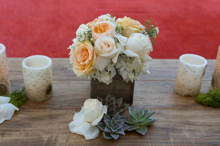 Natural-colored roses, including peach and ivory, were placed in wooden planter boxes on all the tables. Along with succulents, they matched the desert surroundings.