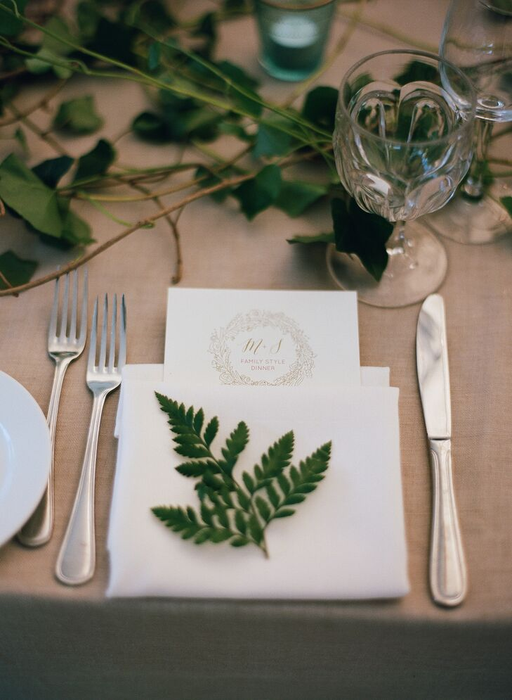 """Michelle put her close friend Kristin's design skills to work, having her maid of honor design the wedding's programs, welcome bags, signage and menu cards. """"We served a family-style meal, but I loved the idea of presenting to our guests,"""" Michelle says."""