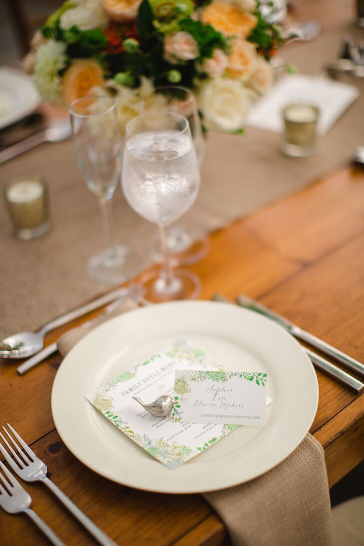 The stationery paid tribute to the garden-party theme, featuring a floral motif in fresh shades of green and whimsical calligraphy. A playful detail that delighted guests were silvery bird cardholders that furthered the decor's summery garden feel.