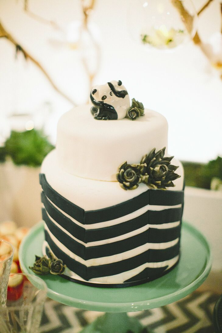 The cake mimicked the reception decor: navy chevron on white fondant with sugar succulents.