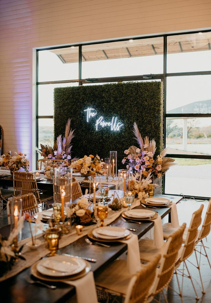 Modern Bohemian Reception with Greenery Wall and Neon Sign