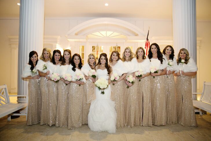 The bridesmaids wore floor-length gold-sequined dresses with white fur stoles.