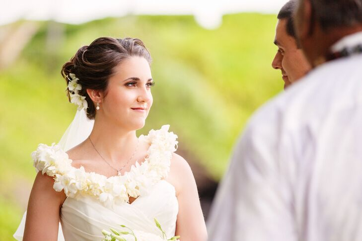 Steph and Nick took part in a lei exchange during their ceremony outside at Kukahiko Estate in Maui, Hawaii. During the Hawaiian tradition, they placed flower leis over each other, symbolic of love, affection and respect.
