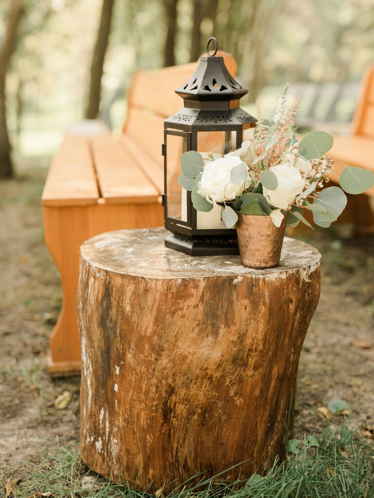 Wooden Tree Stumps With Lanterns and Florals wedding aisle decor