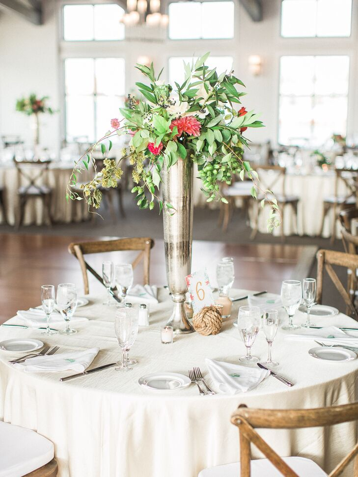 White linens and dinnerware gave each tablescape a natural, simple feel, while towering green and pink centerpieces were housed in silver vessels.
