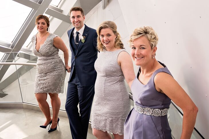 The bridesmaids chose their own dresses in shades of gray, paired with navy heels.