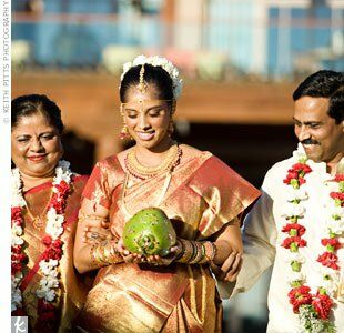 Harini held a beautifully painted coconut (a symbol of fertility) as her parents escorted her down the aisle.