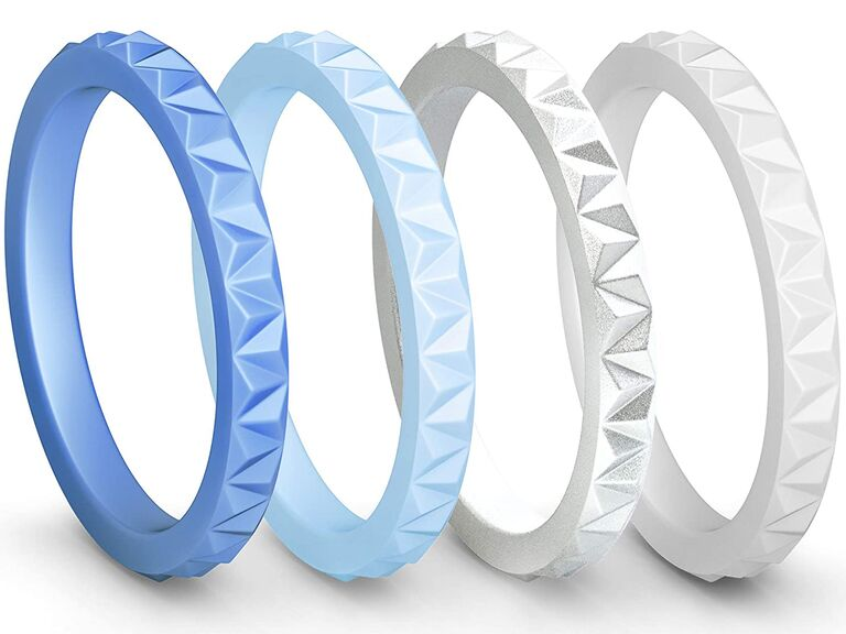 Set of four stacking silicone bands in shades of white and blue