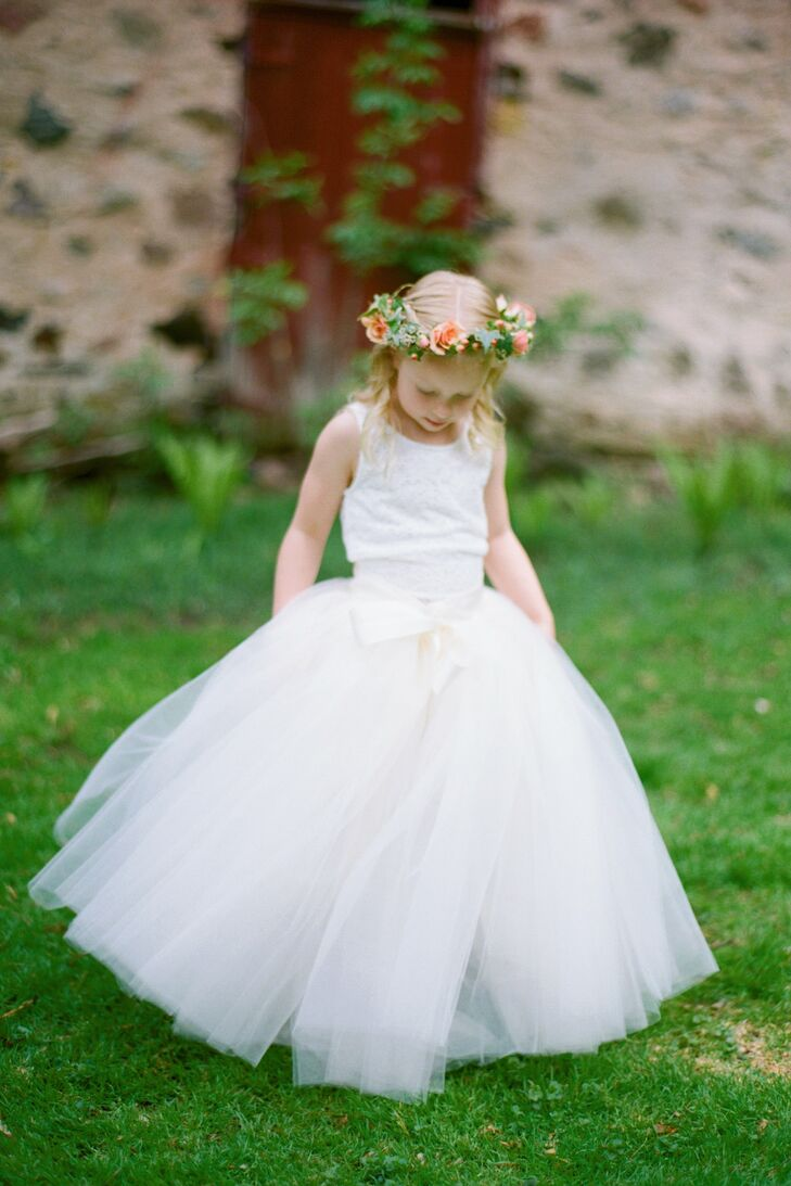 Zoe's flower girl wore a tulle skirt and small flower crown and carried a basket of rose petals.