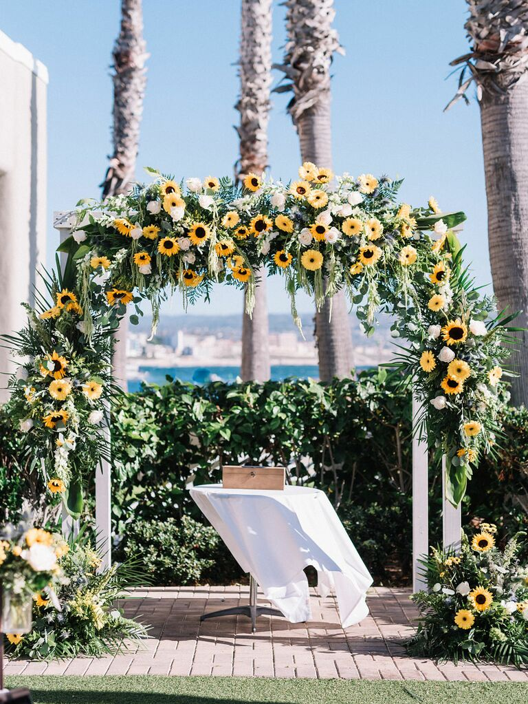 Sunflower arch over wedding ceremony altar at outdoor venue