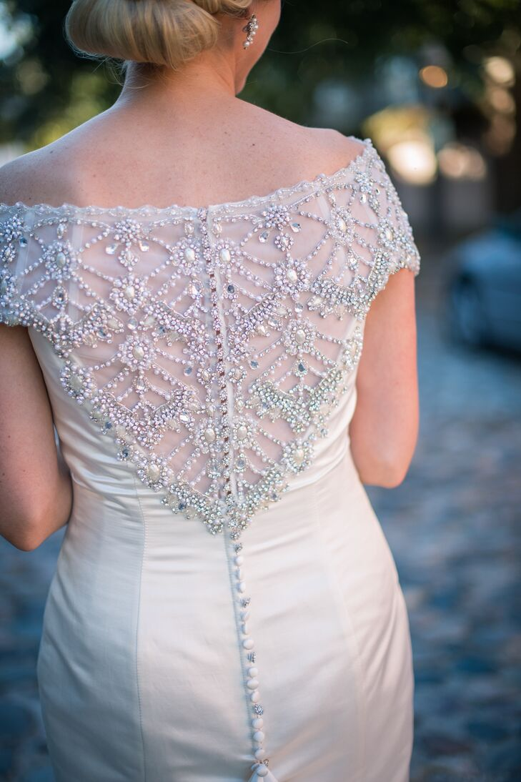 Caitlin's show-stopping Justin Alexander dress featured a sophisticated beaded back.