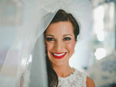 Bride with bright red party lip