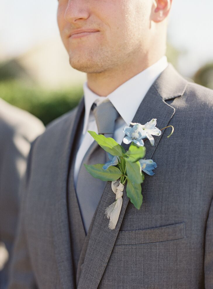 Bailey wore a deep charcoal suit with a light gray tie and a fresh blue blossom boutonniere.