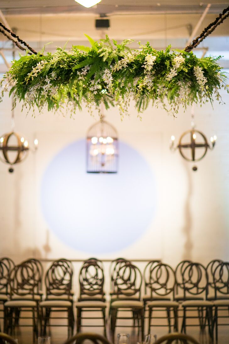 During the ceremony, Chelsea and Chris stood under a natural chandelier made of leaves with ivory bloom accents. The decoration went with the many other natural-looking arrangements, from the bridal bouquet to the dining table centerpieces.