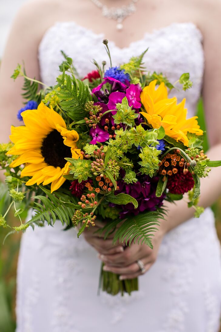 Justine held a lush bouquet of wildflower accents with greenery on her wedding day.