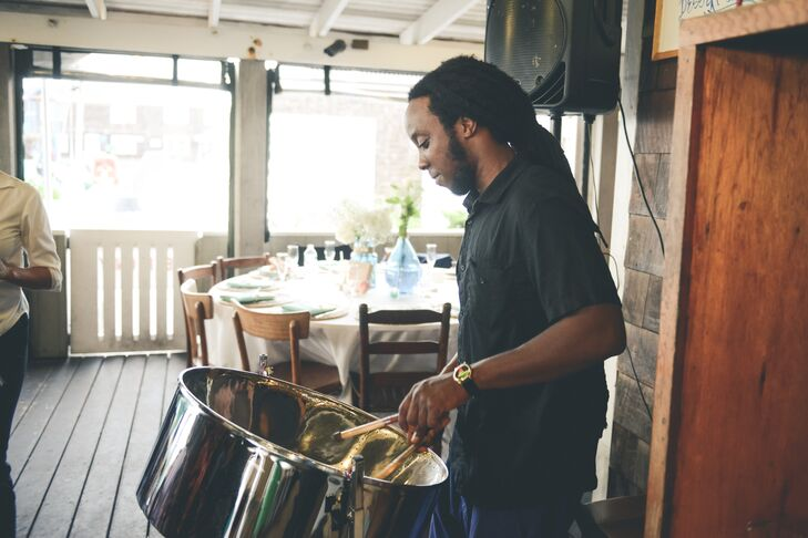 """At the cocktail hour guests were greeted by a musician on a steel drum playing the classic sounds of the islands, as they sipped on the 'Tom the Bomb'—the groom's specialty drink made with fresh frozen lemonade and a sweet tea vodka floater,"" recalls Caitlin."