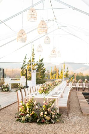 Tented Reception with Rustic Flower Arrangements and Hanging Lights