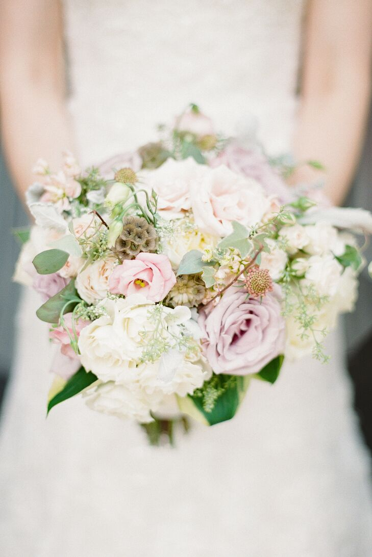 Tara's bouquet was a mix of roses, peonies and waxflowers in shades of blush pink, ivory and lilac.