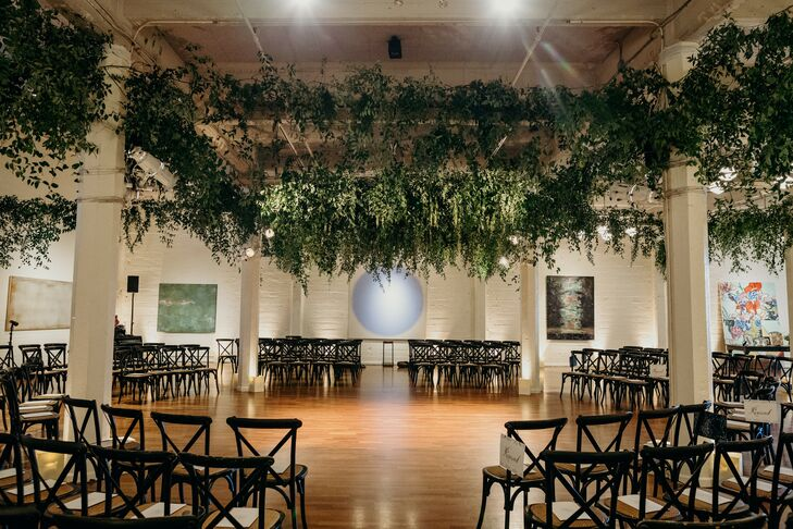 Circular Ceremony Seating with Hanging Greenery Decorations