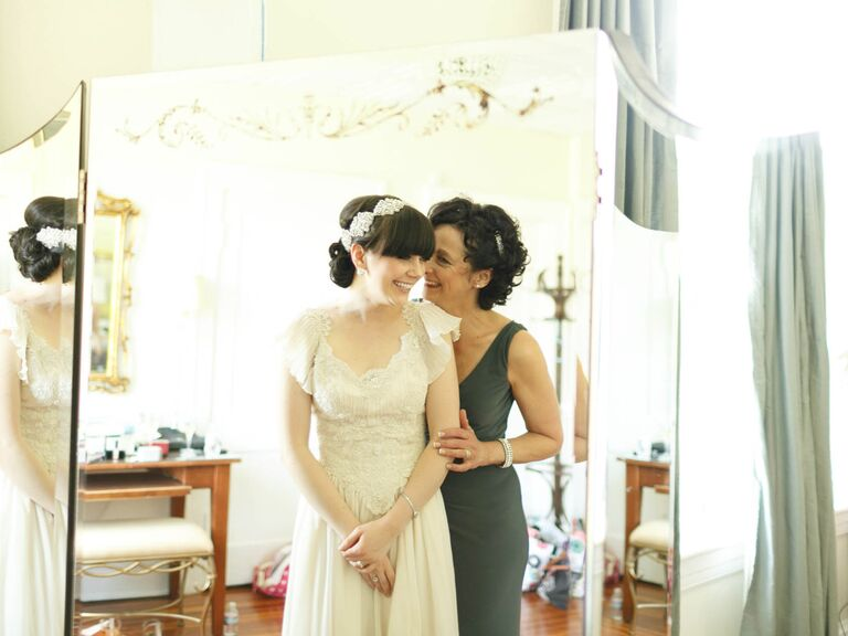 Bride and mother of the bride getting ready on wedding day