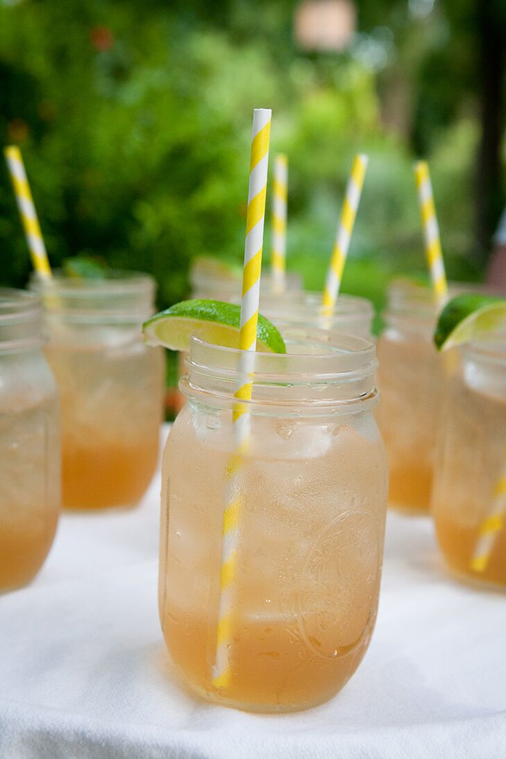 """Guests had a choice of two specialty cocktails, """"His"""" and """"Hers:"""" the """"Classy Cowboy,"""" bourbon and ginger ale, and the """"Cowgirl Cooler,"""" a mixture of lemonade, sweet tea and vodka. The specialty cocktails were topped off with yellow and gray striped straws."""