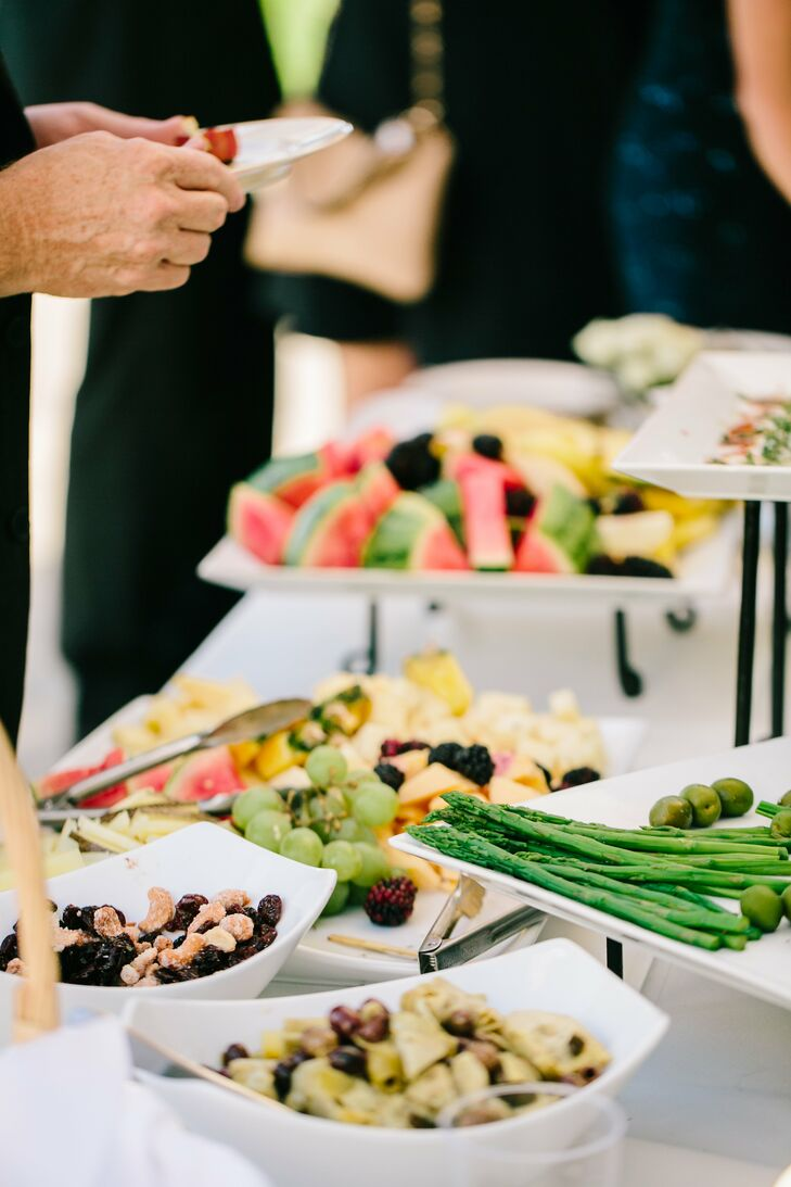 During cocktail hour, guests were treated to a variety of foods including fresh fruit and Italian dishes. If they weren't eating they could wander over to the photo booth for pictures or play a game of corn hole on the lawn.