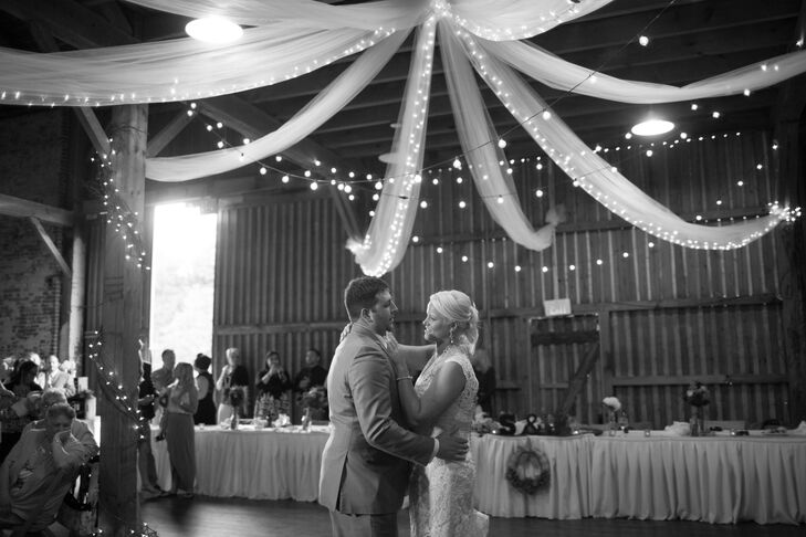 The barn at West Overton was decorated with a canopy of sheer linens and string lights for the reception.