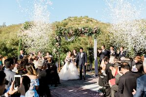 Four-Post Wedding Arch with Vines and Purple Roses