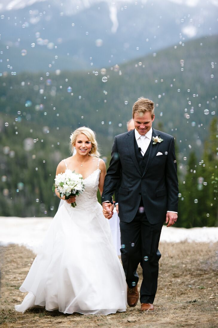 Grace and Luke took their first steps as newlyweds while guests blew bubbles all around them.