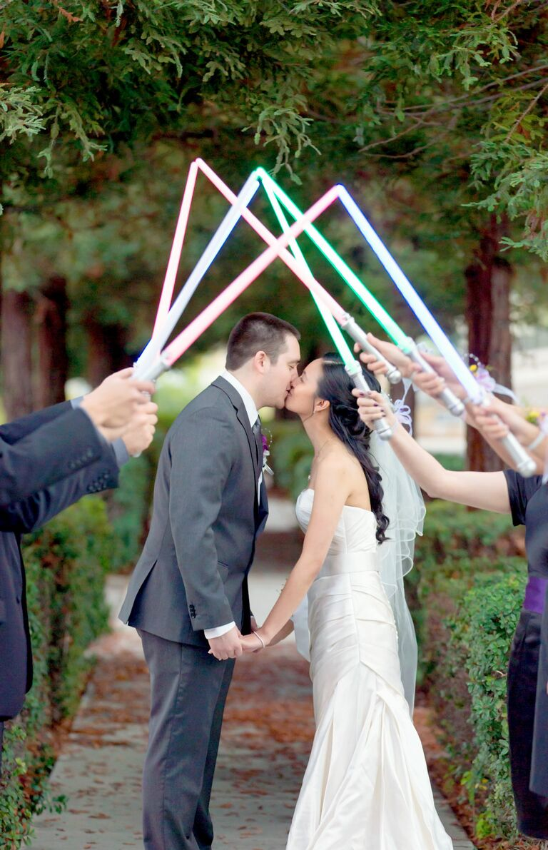 'Star Wars' themed wedding exit with light sabers