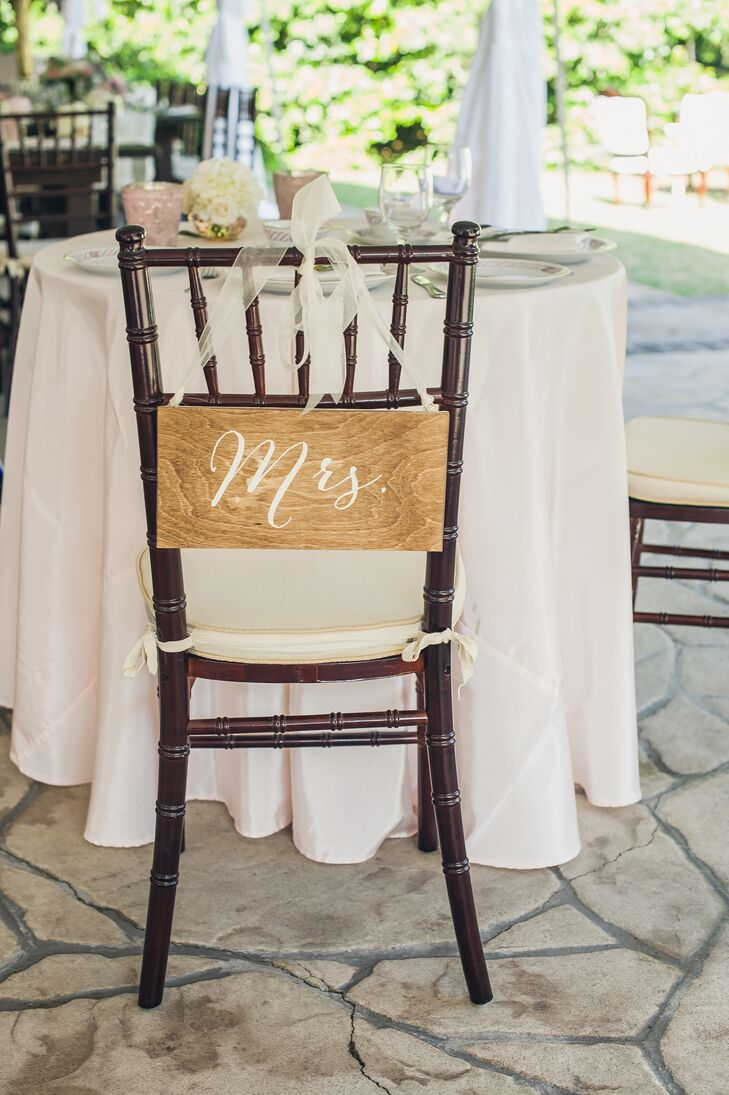 DIY Wooden 'Mrs.' Chair Decor at Reception