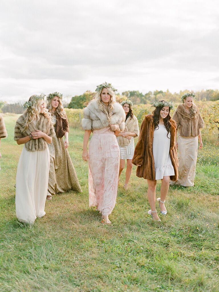 Bride and bridesmaids in faux-fur wraps for a winter wedding