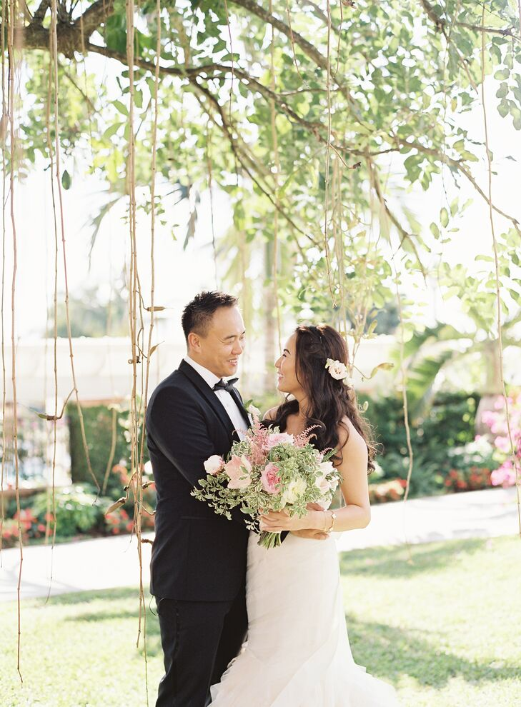 """Prior to their ceremony, Joyce and Jae took a few moments to have a first look. """"After taking pictures with the bridal party, a handful of us crammed into his dad's car and drove to the church,"""" says Joyce."""
