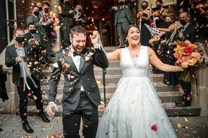 Couple Exiting Church Amid Shower of Flower Petals