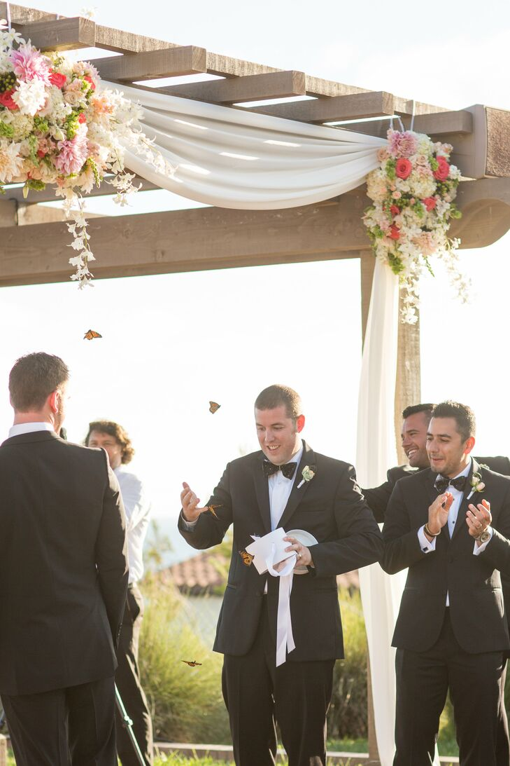 The bride wanted a way to represent both her passed family and her new family in their ceremony. The bride and groom wrote their own vows and released butterflies in honor of her parents.
