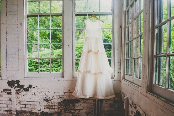 """""""My wedding dress was from J.Crew, but it was customized by my friend to include three tiers,"""" Katie says. """"I saw the dress and it reminded of a milk-glass vase, which I collect, and I decided I could customize it."""""""