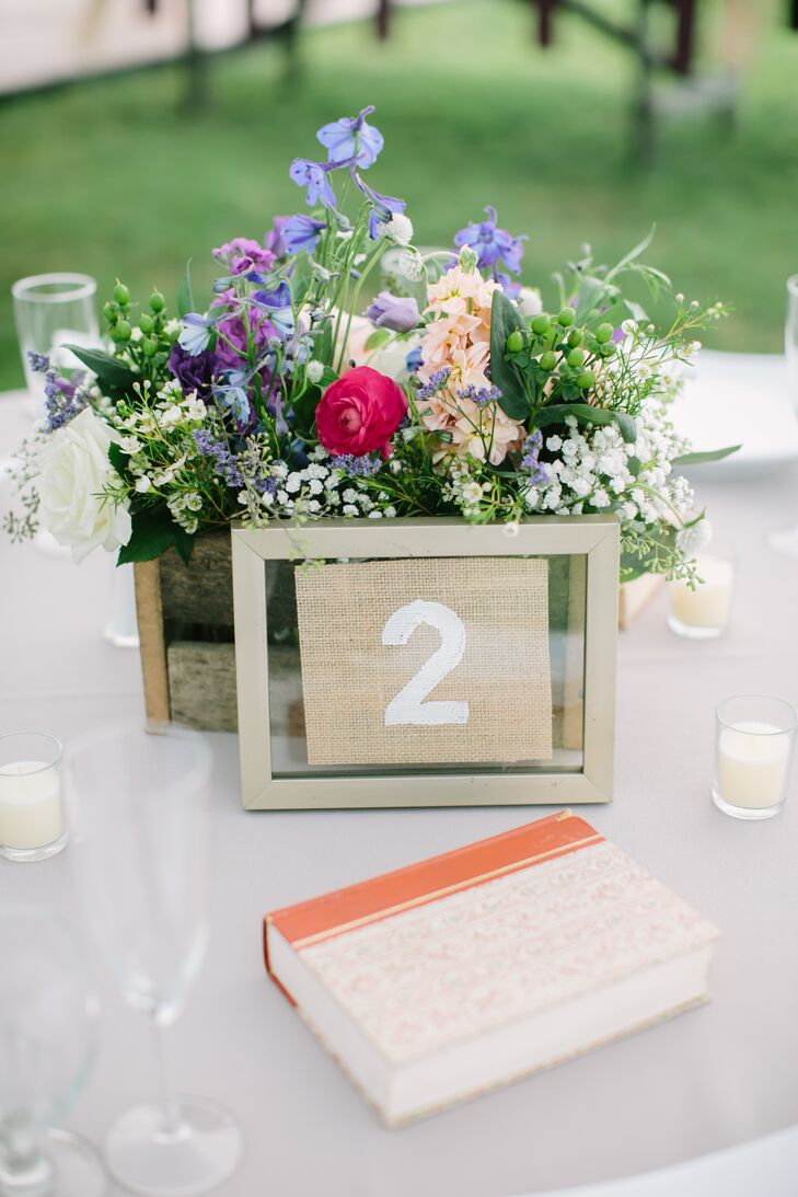 Kimberly took on a few DIY projects to bring her rustic vision to life, while lending the decor a personalized feel. In addition to handcrafting the wooden planter boxes for the centerpieces with the help of her brother, she also painted and framed squares of burlap fabric to create the reception table numbers.