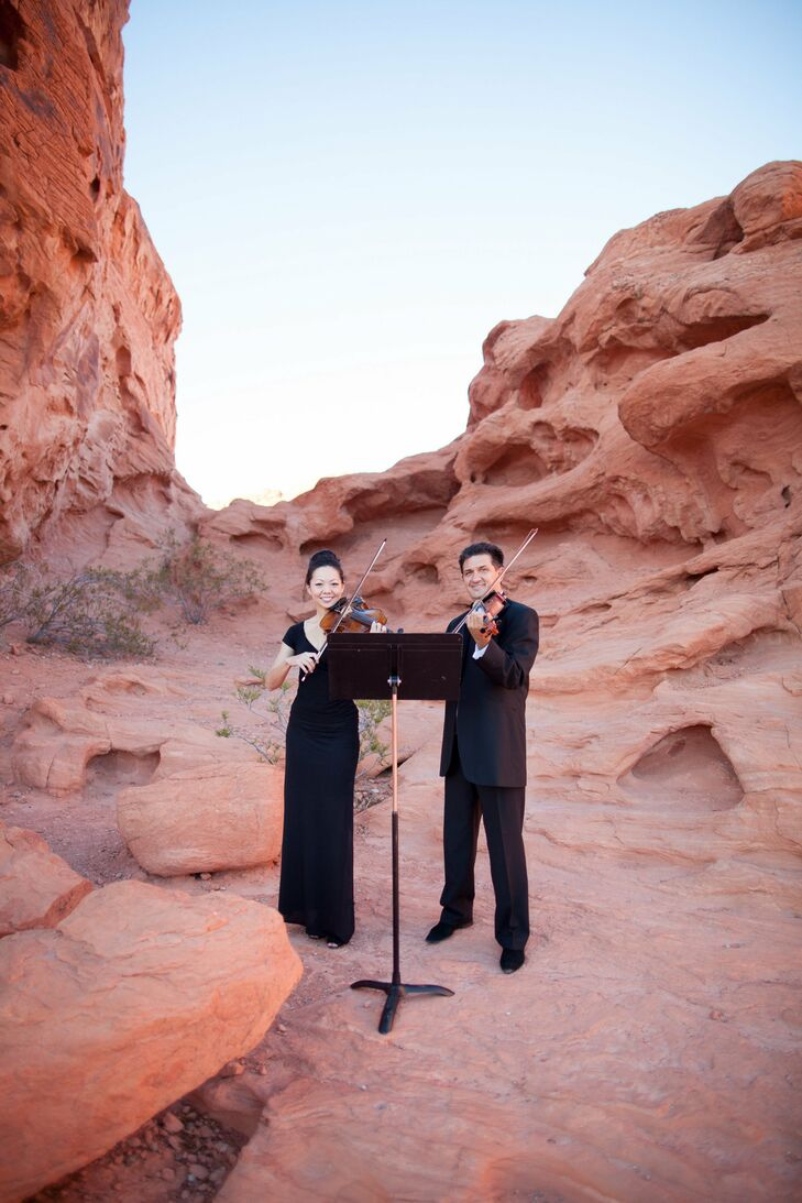 Friend's of the bride and groom played string music against the natural desert background of the ceremony.