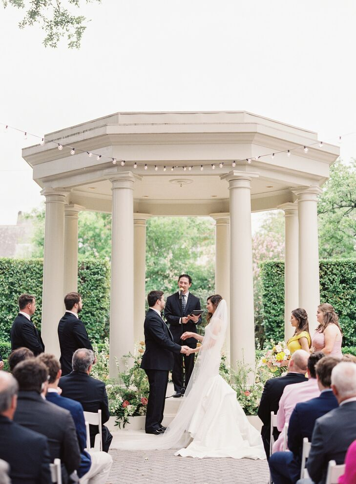 Classic Outdoor Ceremony by White Gazebo with String Lights