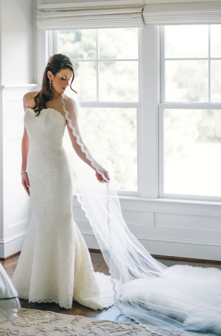 Erin looked radiant in a strapless lace sheath wedding dress by Matthew Christopher, which she purchased at Nordstrom Bridal Boutique. She paired her gown with a dramatic, lace trim cathedral veil.
