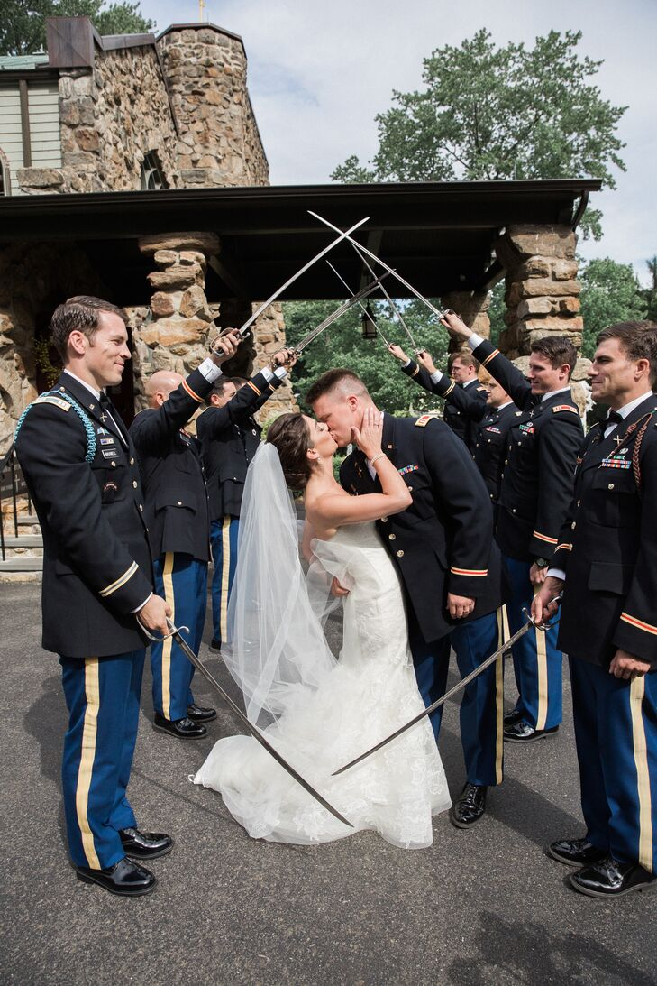 "After exiting the church, Alexandra and Thomas passed through a traditional saber arch. ""As we approached the end of the arch, Tom kissed and dipped me in what made a perfect picture. After the kiss, we walked directly onto the trolley and headed to the reception,"" Alexandra says."